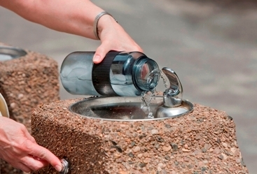 water bottle being filled up at water fountain