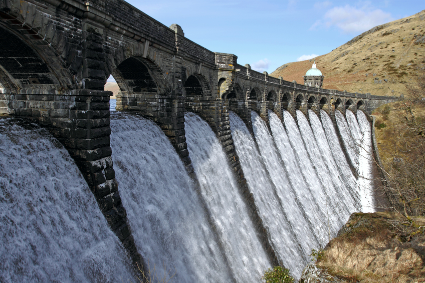 Craig Goch reservoir dam overflowing water, Elan Vally Wales UK.