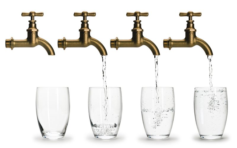 four faucet/taps pouring water in glasses