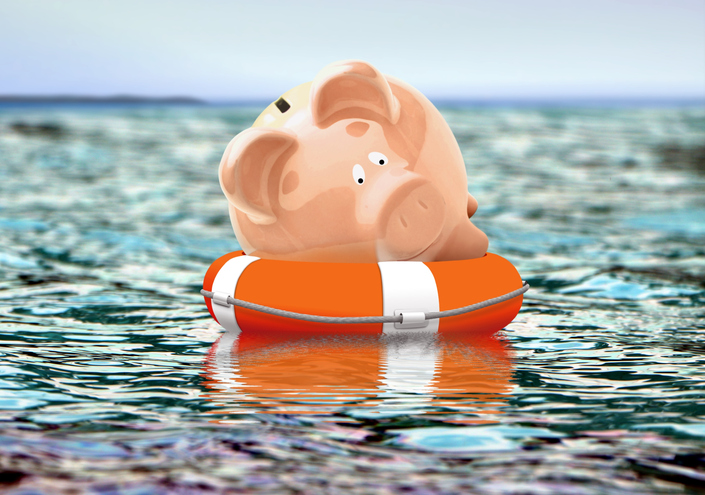 Piggy bank on buoy floating on water