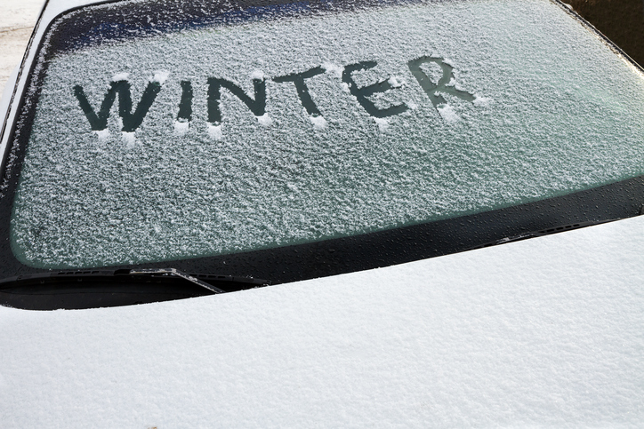 Winter written on a car's front windshield