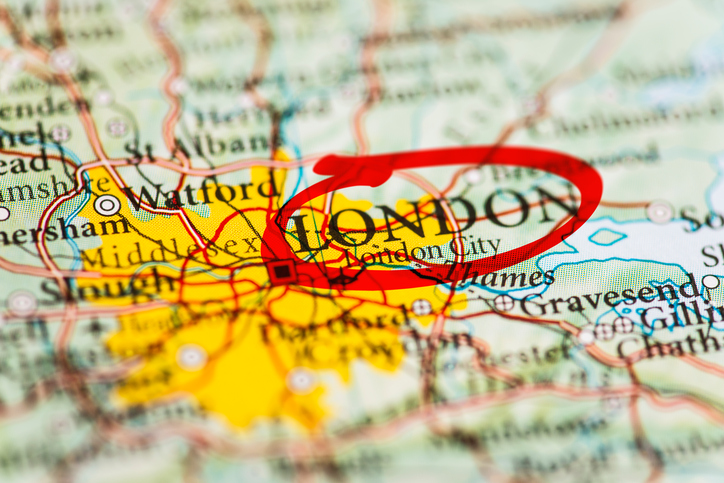 London city circled with red marker on map. Close up shot