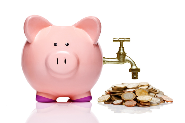 piggy bank with faucet and coins isolated on white