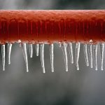 red frozen metal bar