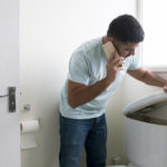 Man checking toilet