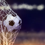 Soccer ball hit the net,success goal concept on stadium