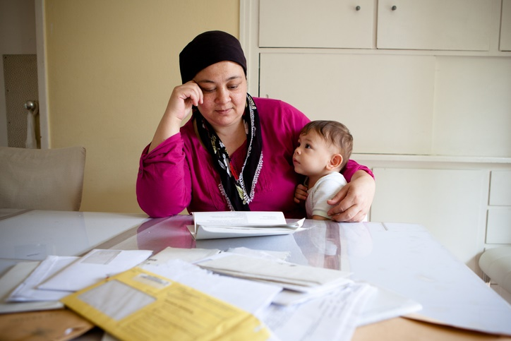 Woman and child looking at bills