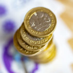 New Twenty pound notes released 20 Feb 2020. Macro close up of this new polymer note with pound coins on top of it