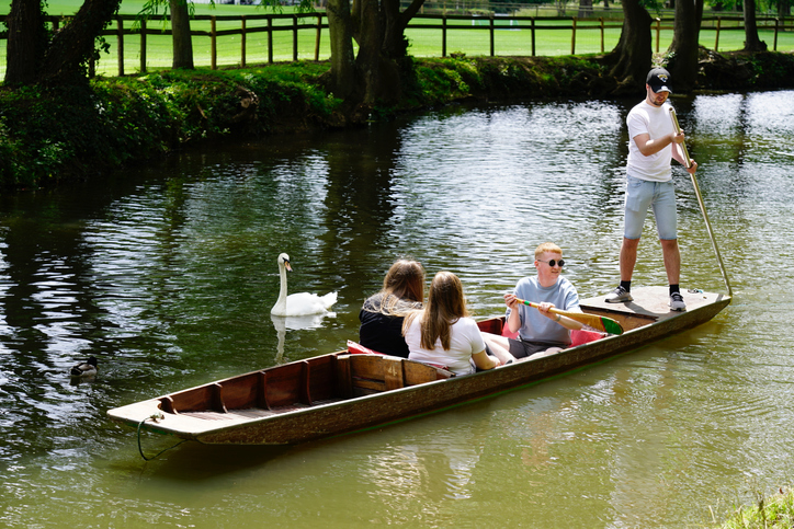 Tourist, visitor punting on river Cherwell